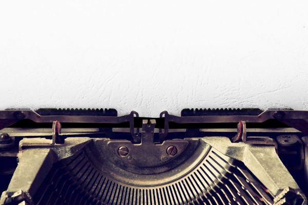 Close Up Image Of Typewriter With Paper Sheet